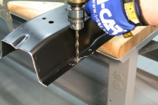 When drilling boron alloyed steel the metal should curl off of the hole.