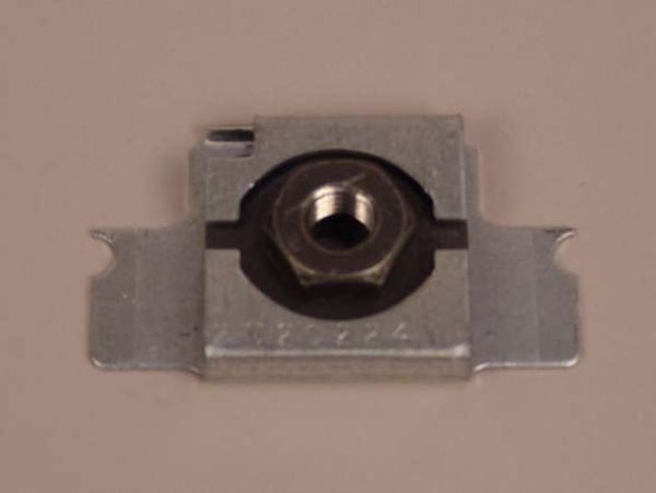 Figure 1 - The body mount bolt cage nut is secured in position inside a cage nut retainer by tabs that are folded against the cage nut.