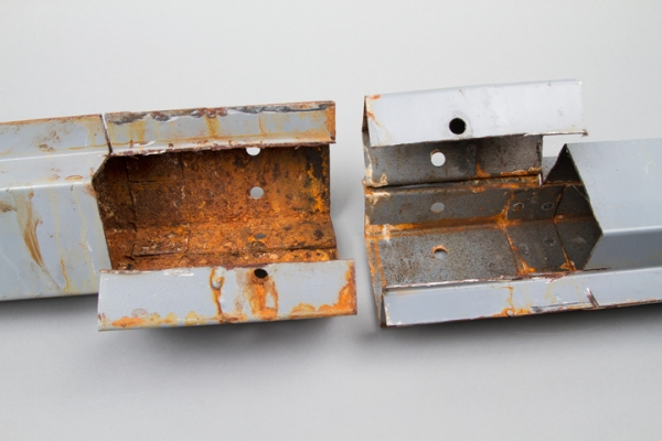 (Figure 1) Rail on left has no corrosion protection applied. The rail on the right has correct corrosion protection.