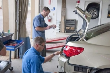 Figure 1 - The estimator is working with a disassembly technician at the vehicle, as it is being disassembled.