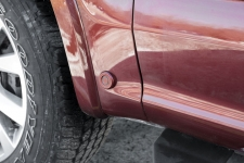 Ultrasonic active park assist sensor, located on the lower half of the fender on a 2015 Ford F-150.